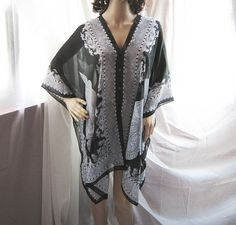 Ancient Indie Prussian Black Absinthe Persian Scripture Paisley Poncho Gypsy Scarf Shawl Cover Up Butterfly Wings Cape Sheer Chiffon Kaftan. $39.80, via Etsy.