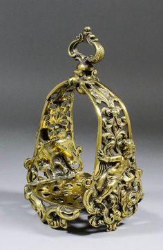 Lot 771 - A fine 18th Century European silvered brass stirrup cast and pierced with winged Putti holding