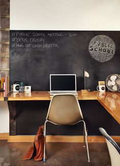 wall-length wood desk against charcoal wall