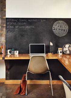 wraparound desk, chalkboard wall