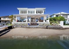 Coastal beachfront property is at a premium in this Queensland, Australia hotspot, but this house design on this densely populated sandy strip feels like a spacious retreat a million miles...
