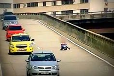 This 8-year-old boy rides his tricycle down a FREEWAY in Brazil! And none of the drivers stop to get him! They just keep driving.  CRAZY PEOPLE!!