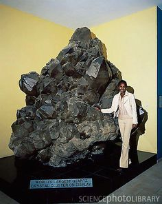 World's largest Quartz crystal cluster on display in Crystal Gallery, Swakopmund, Namibia. This is the world's largest quartz cluster, discovered in 1985 at the bottom of a 45 meter deep cave in the Otjua mine near Karibib in Namibia. It weighs 14,100 kg and took three years to excavate and remove.