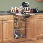 Mixer lift that stores in cabinet when not in use. Great idea for the new kitchen.