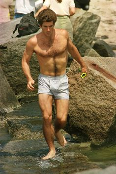 John F. Kennedy, Jr., 1988....its like a vision of the Greek god Eros, god of love, emerging from the Aegean sea!