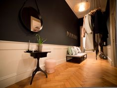 entree / hallway / ecclectic / classic / panelling / black walls / hanging coat rack ligne roset / GUBI Adnet mirror black / daybed / asian art / Farrow & Ball / parquet / shaker table / elephants breath