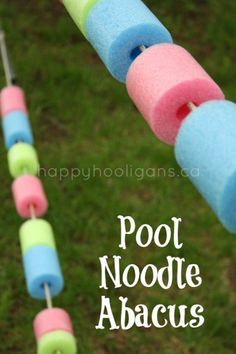 "noodle abacus Pool Noodle Abacus - A backyard tight rope doubles as an ""abacus"" for toddlers.Pool Noodle Abacus - A backyard tight rope doubles as an ""abacus"" for toddlers. Backyard Play Spaces, Outdoor Learning Spaces, Backyard Games, Backyard Ideas, Summer Activities, Toddler Activities, Activities For Kids, Outdoor Activities, Outdoor Games"