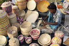 A man engaged in making handicraft products. Handicraft products of West Bengal are world famous. Districts abound in artists making such products with the help of materials such as papier mache, brass, wood, cane, conch-shell, jute, etc. The government of West Bengal provide help to theses artists in showcasing their wares at different handicrafts fairs organized annually.