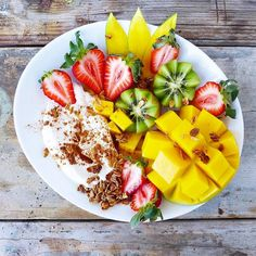 Fruit with coconut yogurt and granola !! I need this right now  Time for a beach walk  http://ift.tt/1P2iTOl by kayla_itsines