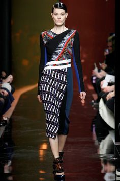 Model Larissa Hofmann at Peter PIlotto Fall 2014 RTW in a dress that combines images of a city skyscraper and palm fronds.