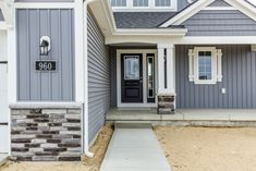 Mayfair Exterior- Eastbrook Homes, MI #HomeExterior #EastbrookHomes #BeautifulHome #Stone #NewHome #realestate