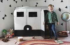 How fun!! A DIY Cardboard Camper Playhouse at The Merry Thought blog