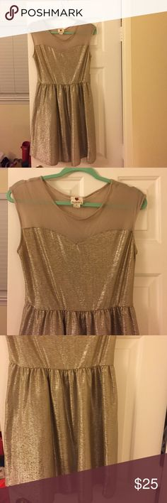 Sassy gold dress :) Adorable gold dress, only worn once or twice maybe. Just have too many dresses and need to clear my closet. If you like it make me an offer :) one clothing Dresses