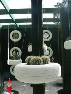 Old tire. New hanging planter.