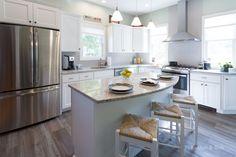 Lakeside Kitchen Designed by RI Kitchen & Bath #RIKB #TransitionalKitchen #StainlessSteel #WhitePaintedCabinets #Island #SubwayTile #HerringboneTile #Backsplash