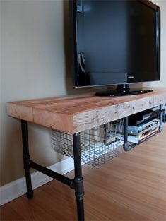 """Dimensions: 18"""" Width x 20"""" Height x length of your choice Wood Top Thickness: Slim: 1.65""""-1.75"""" or Thick 2.5""""-2.75"""" • Handcrafted and sustainable. Made of reclaimed, old growth wood from dismantled buildings in Chicago and barns in the Midwestern US • Fits 30-52"""" size TV. The TV pictured is 40"""" • Includes 2 Vintage locker baskets and Pipe Media shelf"""