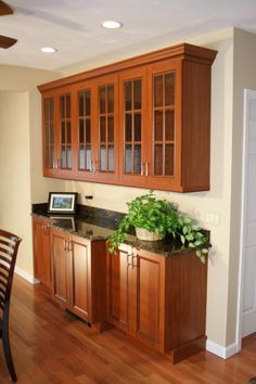 Glass cabinets over buffet in adjacent dining area