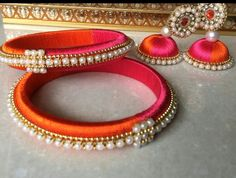 Pink and orange combination silk thread bangles with earrings To buy plz WhatsApp on 9703713779 Silk Thread Earrings Designs, Silk Thread Jhumkas, Silk Thread Bangles Design, Silk Thread Necklace, Silk Bangles, Bridal Bangles, Thread Jewellery, Diy Jewellery, Jewelry Making