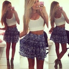 Reasons this is a no: 1. The shirt shows cleavage 2. The shirt is midriff baring 3. The skirt is too short