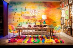 ColorBomb | Garrison Hullinger Interior Design | Garrison Hullinger covered his dining table in decorative Japanese washi tape in bright, brilliant hues. A Technicolor wall treatment and rug and eclectic wall art run with the wild and colorful palette.