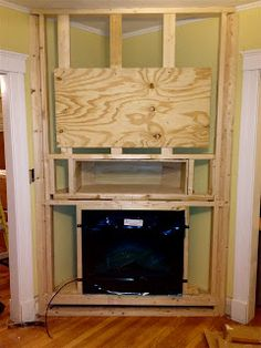 thomas j. remodeling LLC: Build out for a Built-in Electric fireplace in Arlington, MA