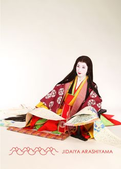 A woman dressed in junihitoe at a kimono photography experience