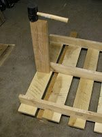 Taking apart pallets without special tools: mallet, board, something to hold up the pallet on the bottom.