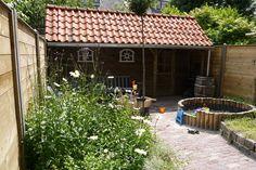 Kindvriendelijke tuin met verhoogde bloemborders