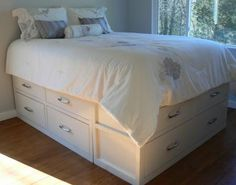 Queen storage bed. You can build this one yourself. will need to try this!