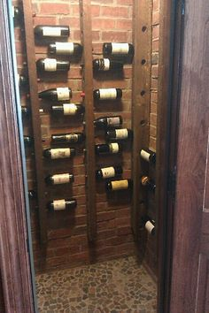 Small wine cellar with 2x4's to hold wine bottles. Great Idea!