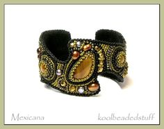 I love this bead embroidery bracelet.  The shape is in one of Sherri Serafini's books.
