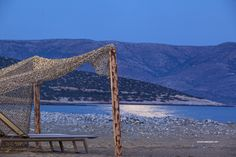 and the wind is still strong here…At the Aegean islands; it calms during the night when the sea waves stand still and the full moon is reflecting on the water surface. I am waiting for the blue moon's rise from the mountains of Naxos. Wrapped around my jean jacket and scarf and with a beach…