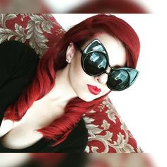 IG's @ jskahh is reminding us of the eccentric and fabulous Peggy Guggenheim with her killer sunglasses and luxurious surroundings. This elegant beauty used our Pillarbox Red for her rich, red velvet locks, and we recommend CS Red Lethal Lipstick for a great match.