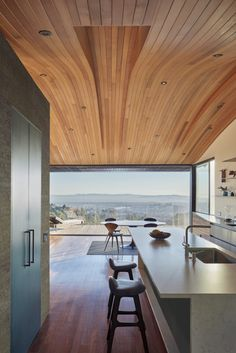 Small House With A Wavy Roof And Gorgeous Bay Views
