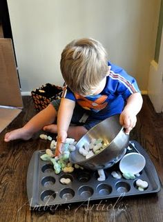 There are some fun activities here!  I especially like the one shown in the picture - muffin tin surprise!  Activities for 12-18 month old kids