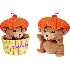 """Petcakes: Honey Cakes is a plush bear featuring a """"orange frosting"""" hat with embroidered bees and comes nestled down in a yellow cupcake wrapper."""