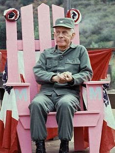 Actor Harry Morgan sits on the set of TV series 'MASH' in Los Angeles, California in 19/09/1982 file photo. The Emmy-winning character actor died 07/12/2011 aged 96