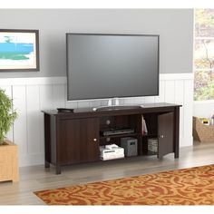 Add style to your living room with this Inval 60-inch TV stand. Finished in espresso, this TV stand adds a nice focal point with ample storage for your equipment needs.