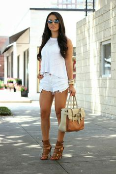 White Top: AE  Similar (Here) & (Here) Distressed shorts: Forever 21 (Similar) Bag: Shoedazzle (old)  (Similar) Sunglasses: Ray-Ban (Here) Heels: (old) Similar (Here)