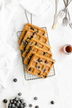 Learn how to make the best ever healthy blueberry waffles from scratch! Light and fluffy on the inside & crispy on the outside! Only 108 calories! Healthy Waffles, Healthy Oatmeal Recipes, Healthy Granola Bars, Healthy Muffin Recipes, Healthy Muffins, Healthy Cookies, Healthy Treats, Healthy Baking, Blueberry Waffles