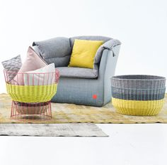 The Bask collection is a mix between a modern, wire-framed basket and a traditionally-woven basket. After visiting a company in Spain that produces yarn with paper in it, he was inspired to make these baskets. What's cool is you can flip them upside down and use them as side tables.