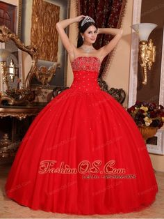 Romantic Red Quinceanera Dress Strapless Tulle Beading Ball Gown-   http://www.fashionos.com  http://www.facebook.com/fashionos.us  You`re sure to be a heart-breaker when you`re wearing this magically elegant strapless ball gown! Its classic design is spiced up by a beautiful illusion panel that dominates the midsection. It`s adorned with glittering appliques and sparkling crystals for a rich and stylish look.