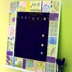 This magnetic board only looks like it has a fancy ceramic tile frame.