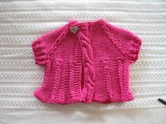 Ravelry: Tiny Cables Baby Sweater pattern by Carmen Oliveras