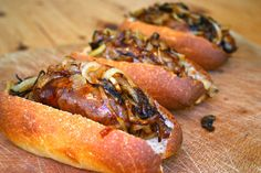 cider braised lincolnshire sausage hot-dogs with caramelised onions