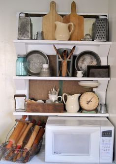 @Ashlee Szymanski...white shelves with vintage goodies!!  Love the wire basket with lots of rolling pins!