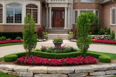 Colorful and neatly manicured landscaping elements add the curb appeal necessary for a powerful first impression