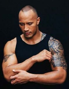 """Dwayne """"The Rock"""" Johnson.  He's like a giant teddy bear when I've seen him interviewed.  Adorable.  Plus he has some gorgeous tattoos."""