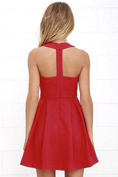 If your sole objective is to look one hundred percent cute, than look no further than the Mission Com-pleat Red Dress! A rounded halter neckline takes shape in a medium-weight woven poly that drops to a fitted, darted bodice with T-strap back. From the fitted waist, playful box pleats flow into the flaring skirt. Hidden back zipper with clasp.