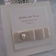 I just love designing and creating new invitation designs for our handmade wedding invitation range.  This design uses a luxury satin ribbon and rhinestone and pearl brooch.